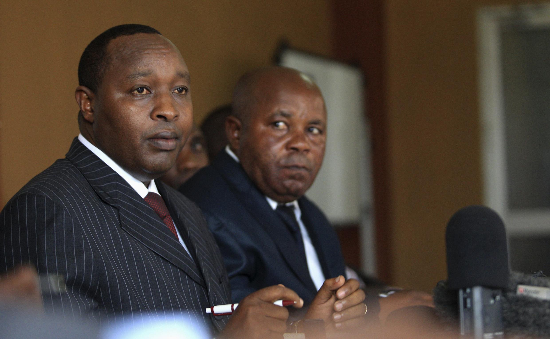 The M23 insurgent rebels' executive secretary Francois Rucogoza (L) speaks during a press conference in Uganda's capital Kampala