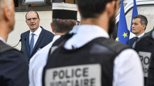 rench Prime minister Jean Castex (L) addresses police officers next to French interior Gerard Darmanin (R) during a visit at Dijon's police headquarters, on July 10, 2020.