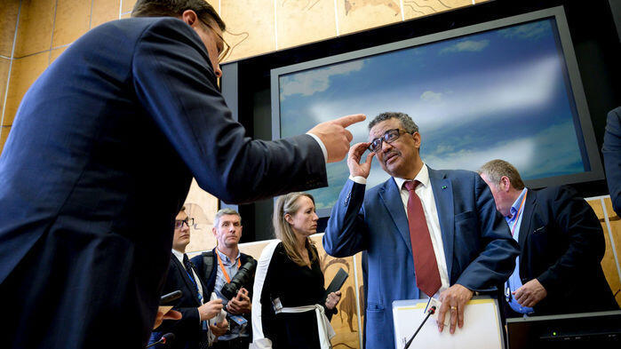 """World Health Organization Director-General Tedros Adhanom Ghebreyesus (right) at a high-level meeting where he called the first Ebola case in the crossroads city of Goma """"potentially a game-changer."""" Geneva, 15 July 2019"""