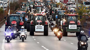 "French farmers drive their tractors on the A6 motorway on their way to Paris, 27 November 2019. The slogan reads ""Macron, answer us."""
