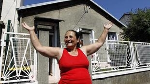 A Roma woman outside her house in Paris
