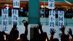 Anti-government protesters hold a rally in a shopping mall in Sha Tin, Hong Kong, China.