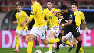 Serge Gnabry (2nd R) scored Germany's first-half goal against Romania in Bucharest on Sunday