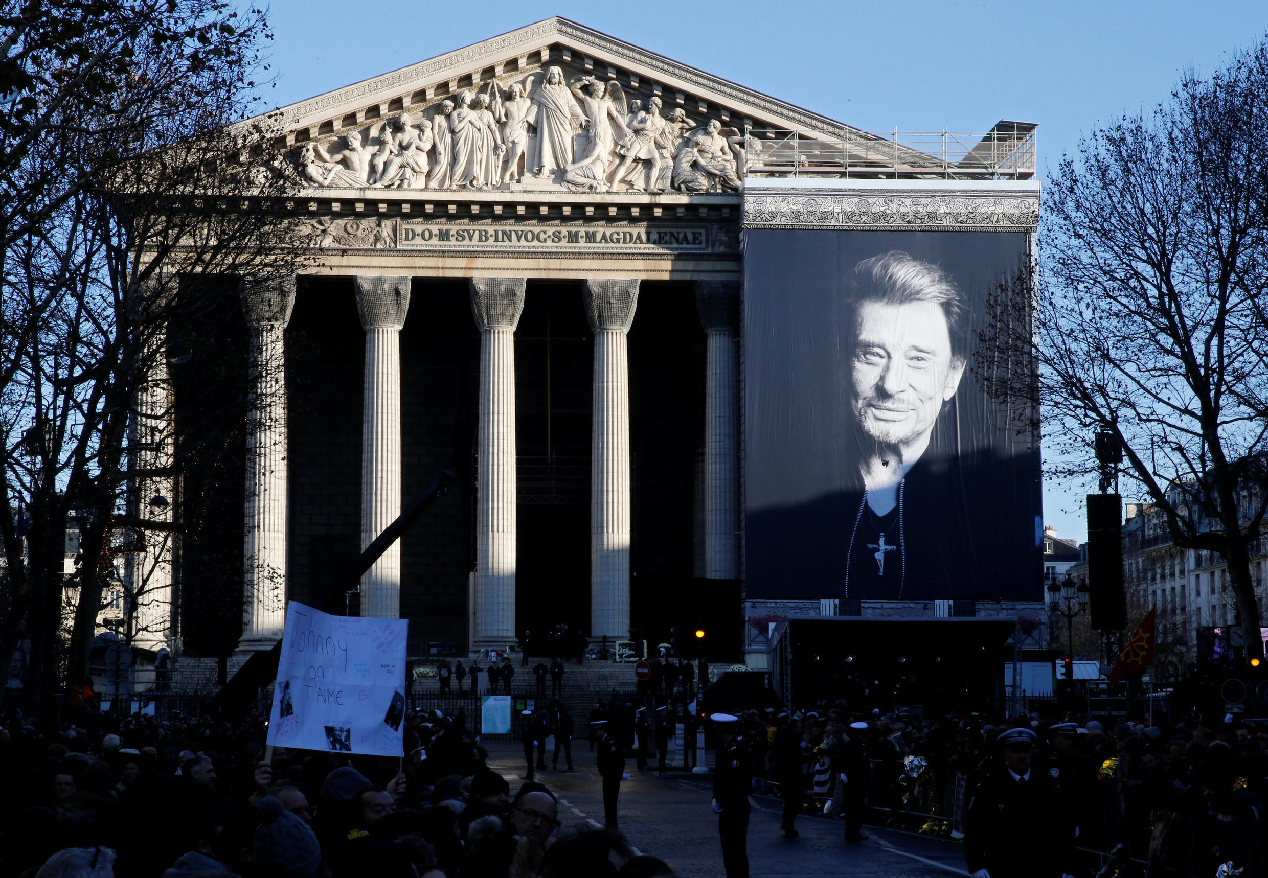 A photo of Johnny Hallyday hangs outside La Madeleine Church in Paris on 9 December 2017.