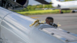 Handout picture released by the Colombian presidency showing damage to President Ivan Duque's helicopter at the Camilo Daza International Airport in Cucuta, Colombia on June 25, 2021