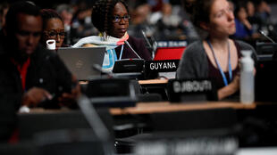 Participants listen to a debate at the plenary session during COP24 UN climate change conference 2018 in Katowice.
