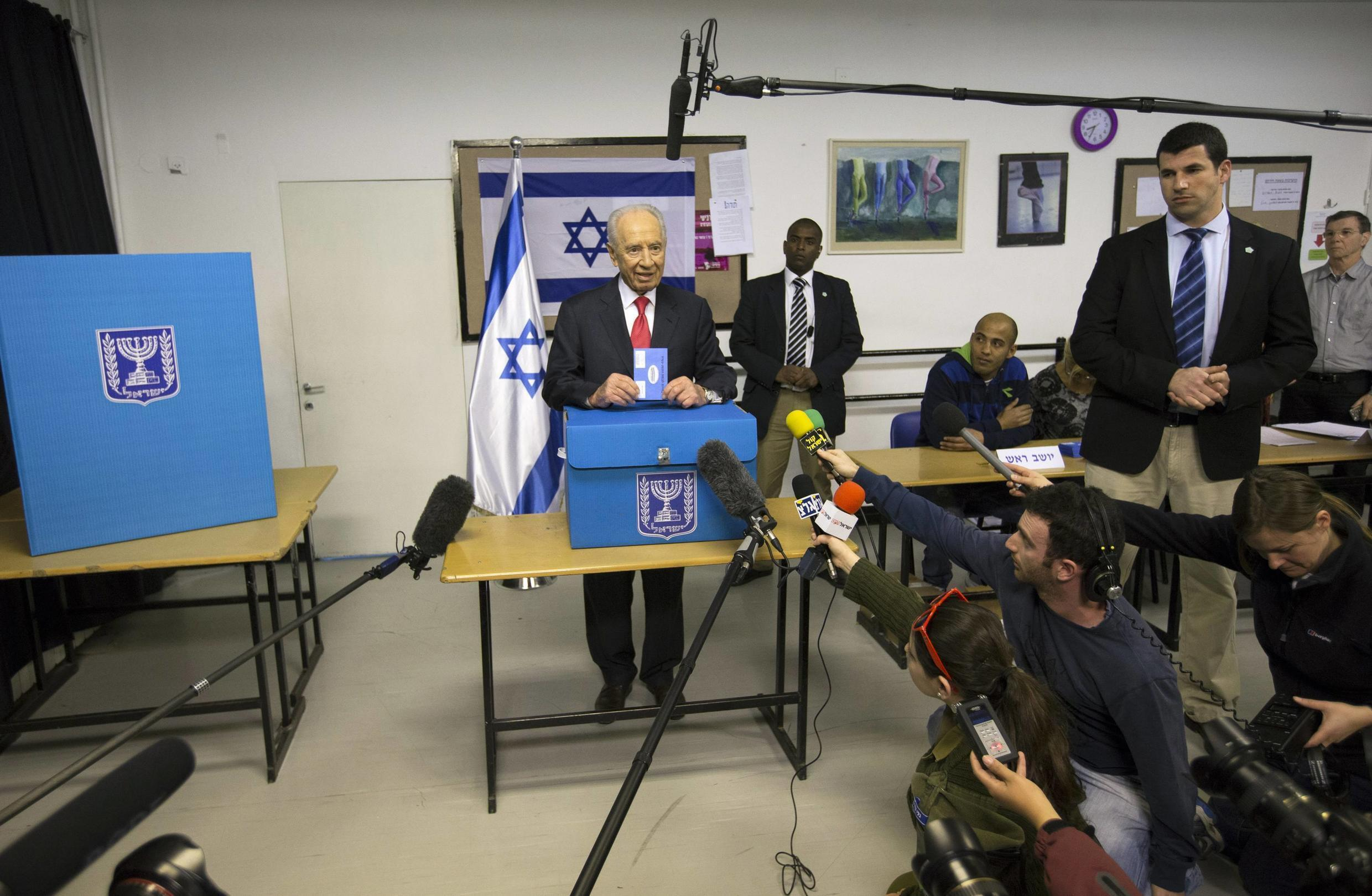 Israel's President Shimon Peres casts his ballot for the parliamentary election at a polling station in Jerusalem 22 January