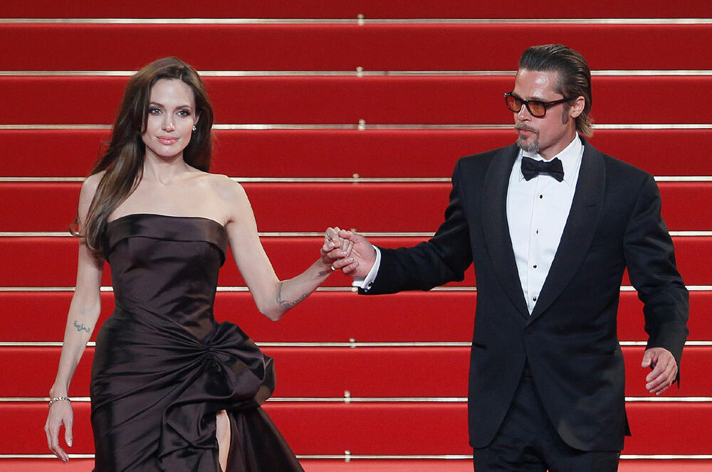Although divorced, Angelina Jolie and Brad Pitt are looking to form a champagne partnership in France. File photo from Cannes film festival