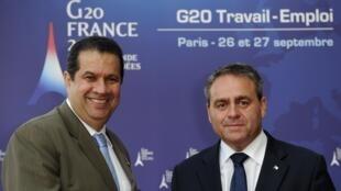 Os ministros do Trabalho do Brasil, Carlos Lupi, e da França, Xavier Bertrand, participam da reunião do G20 em Paris