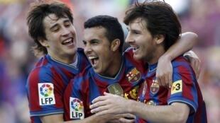 Les Barcelonais Bojan Krkic, Pedro Rodriguez et Lionel Messi.