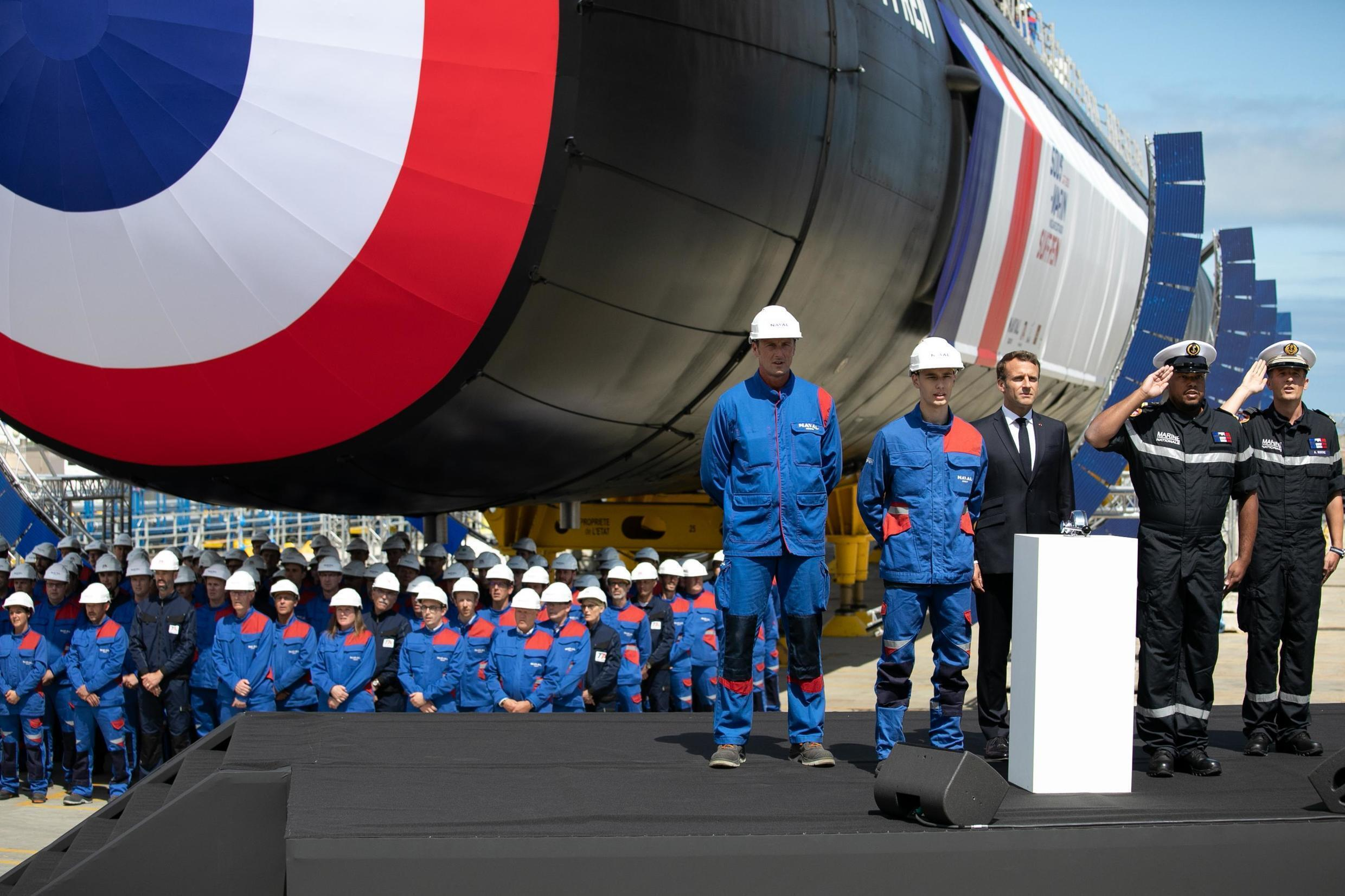 """French President Emmanuel Macron attends the official launch ceremony of the new French nuclear submarine """"Suffren"""" in Cherbourg, northwestern France, 12 July 2019."""