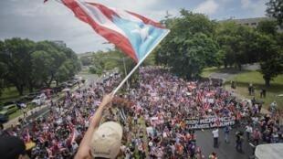 Les Portoricains sont descendus dans la rue à San Juan le 25 juillet 2019 lendemain pour fêter la démission du gouverneur Ricardo Rossello.