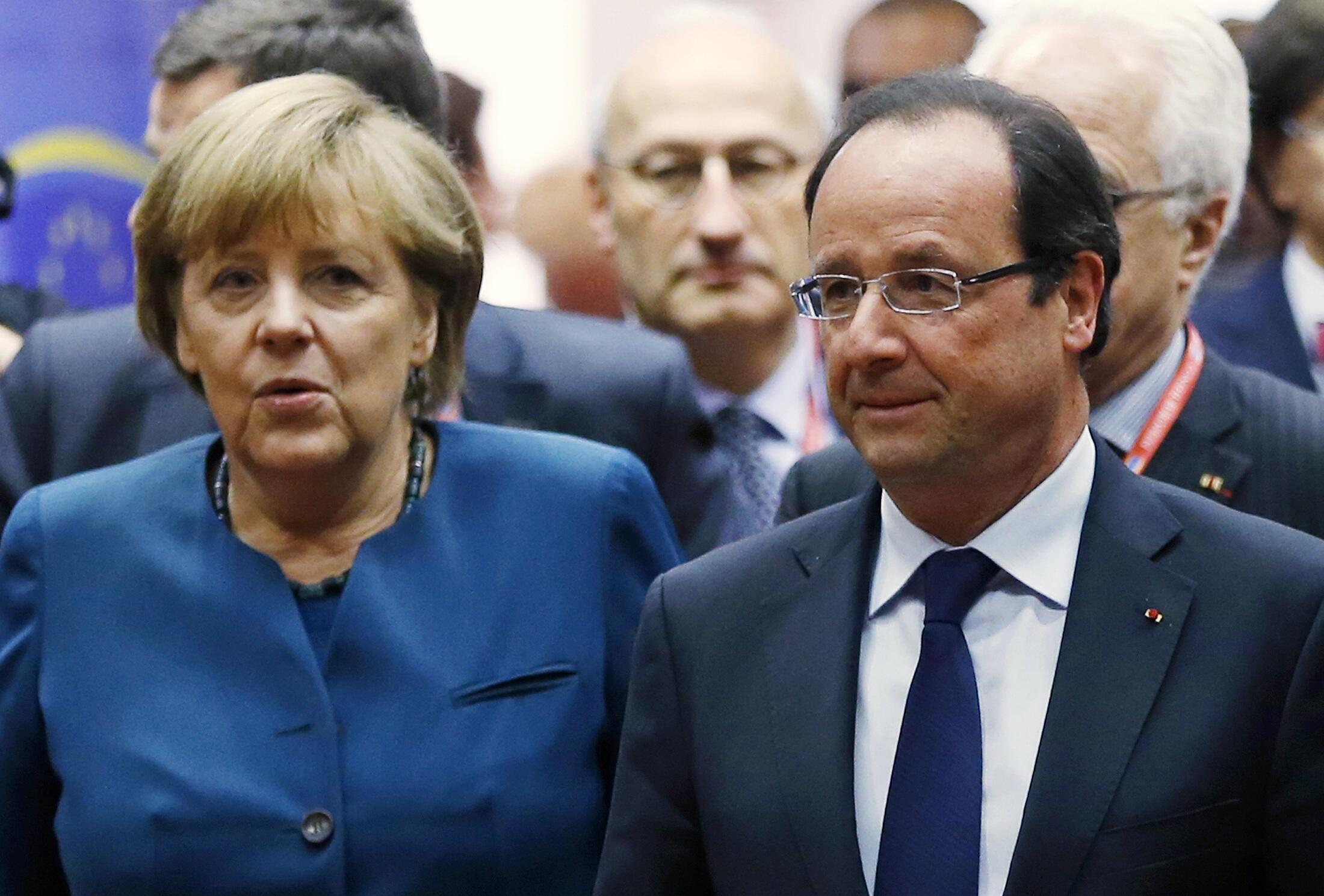 Angela Merkel e François Hollande em Bruxelas