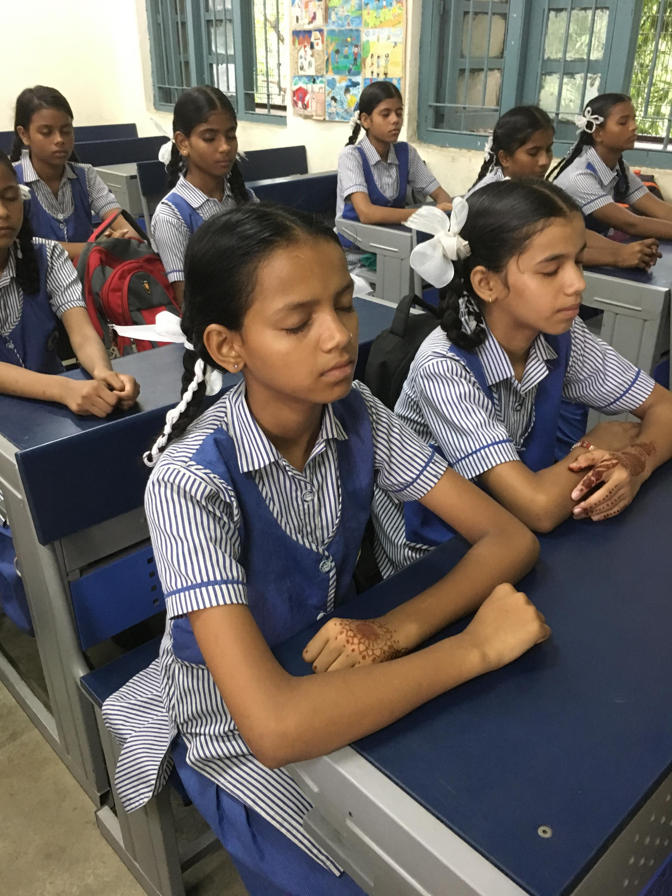 Students practice meditation as part of their happiness curriculum, Delhi, India