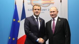 Эмманюэль Макрон и Владимир Путин встретились на полях саммита «большой двадцатки» в Гамбурге, 8 июля 2017 года