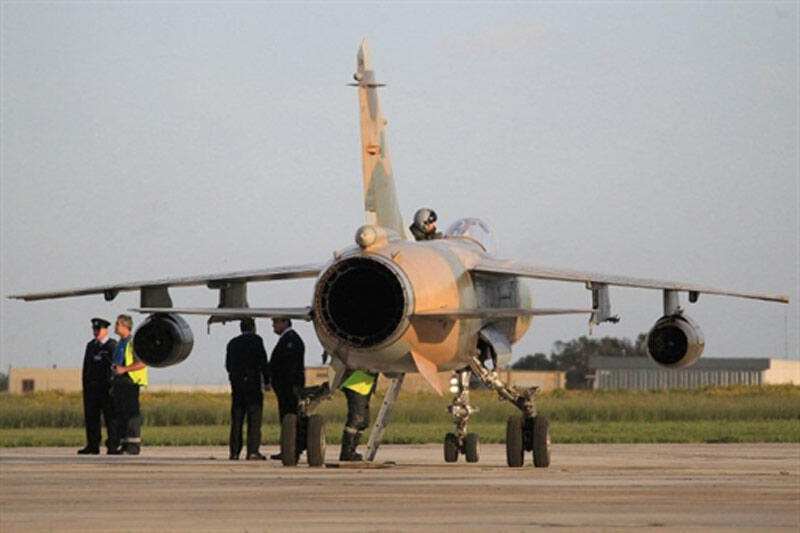 A French-made Mirage jet on the tarmac in Malta after its pilot defected