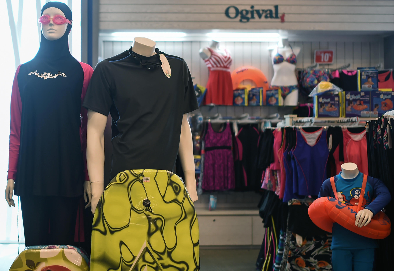 A 'burkini' full-body swimsuit is seen on the left in a shop in Kuala Lumpur.