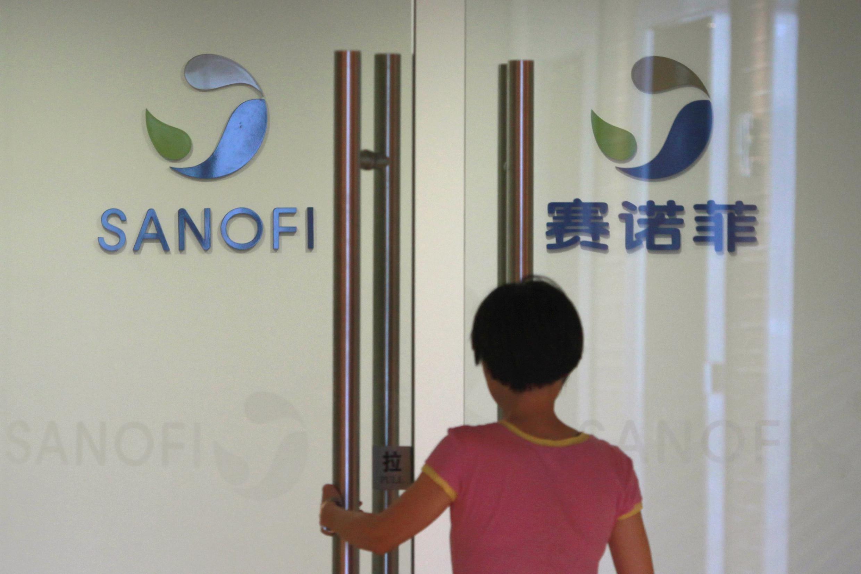 An employee enters pharmaceutical company Sanofi in Shanghai.