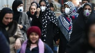 Iranian women wearing protective masks to prevent contracting a coronavirus walk at Grand Bazaar in Tehran, Iran February 20, 2020.