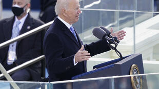 Joe Biden speaks at his inauguration as president, saying 'America has been tested anew, and America has risen to the challenge.'