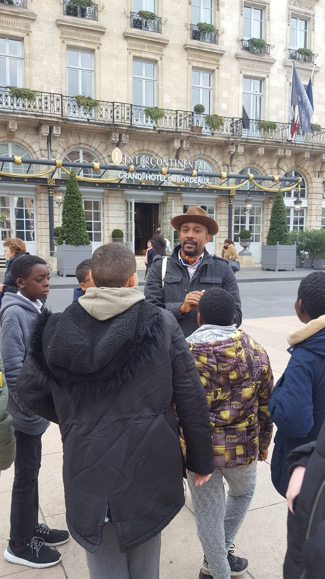 Karfa Diallo, coordinator of Black History Month leads a group of schoolchildren on a tour of Bordeaux's slavery past, 19 February, 2019