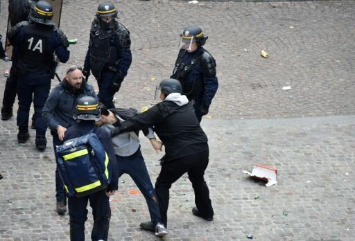 A screen shot from a video showing Alexandre Benalla, wearing a police helmet, manhandling a protester in Paris in 2018.