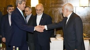 US Secretary of State John Kerry shakes hands with Iran's Foreign Minister Mohammad Jawad Zarif (R) in Montreux on Monday