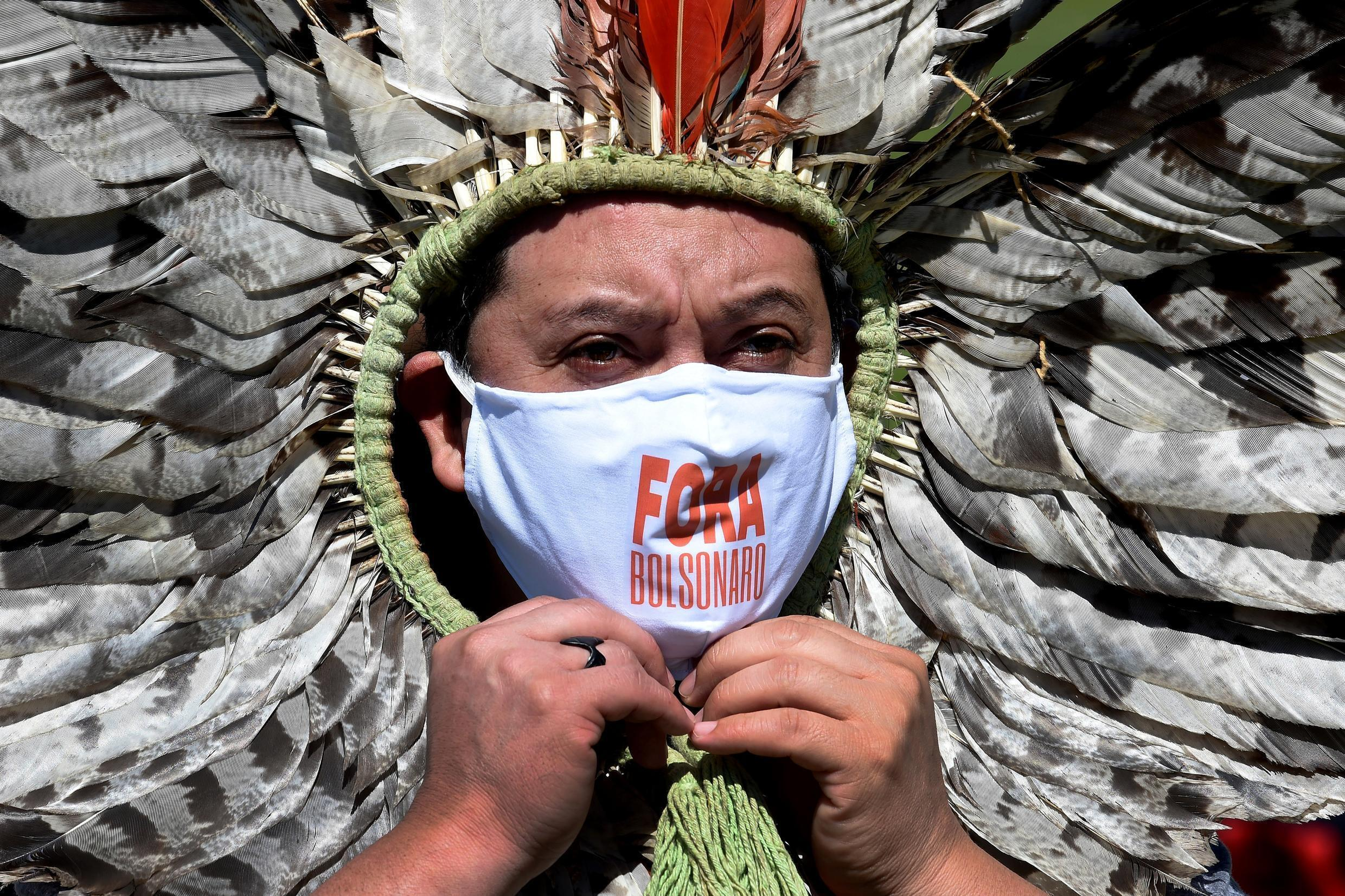 Indigenous Kaingang leader Kretan Kaingang marches in protest against President Jair Bolsonaro as Brazil's COVID-19 death toll reaches new heights