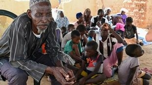 Belem Boureima, a 74-year-old farmer, and his family. They are among the hundreds of thousands of people in Burkina Faso who have fled their homes because jihadist attacks