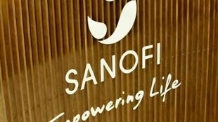 Sanofi expressed confidence it would boost profits for the year despite write-downs pushing the company into a second-quarter loss