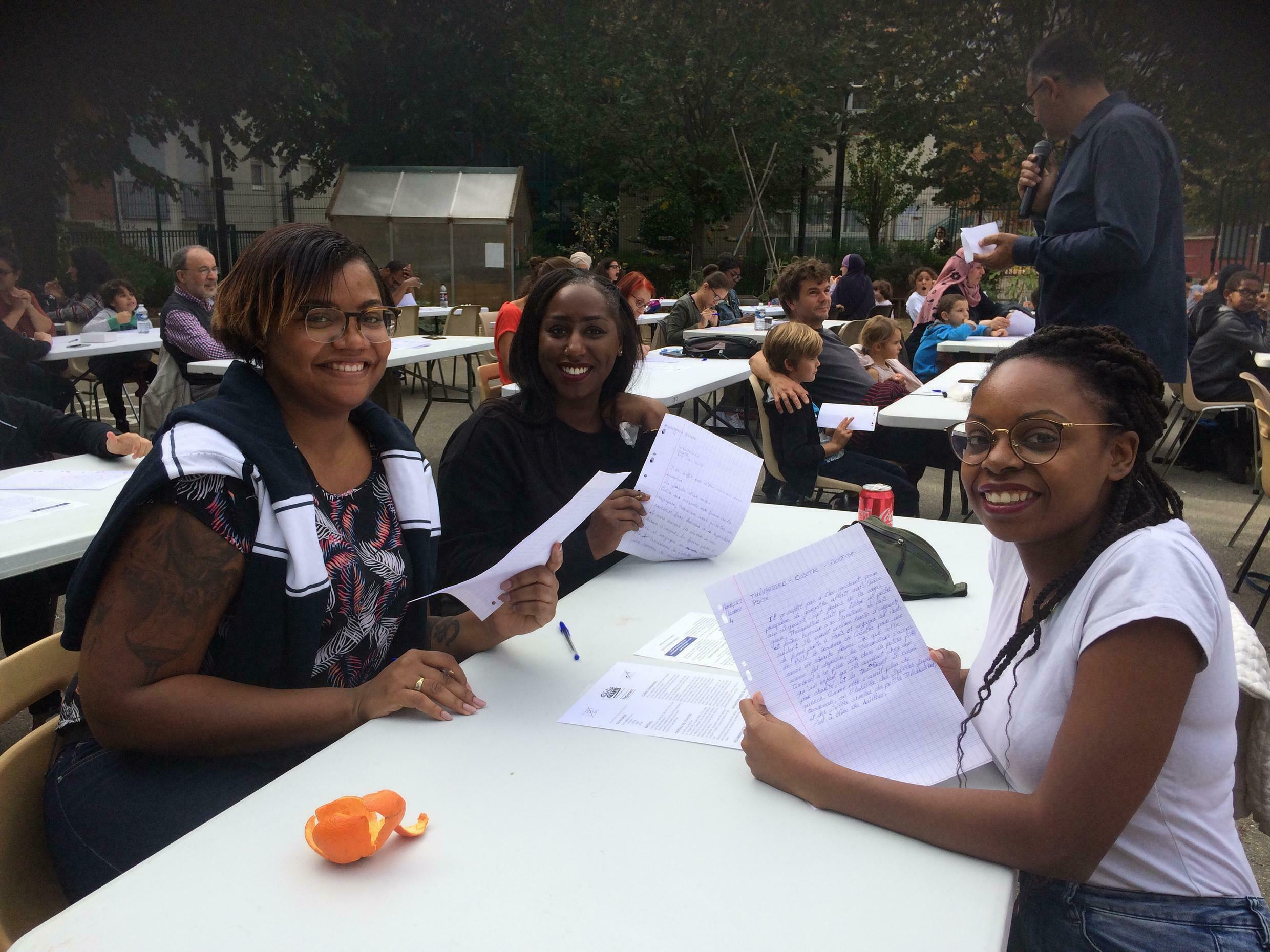 Mélodie, Jessica, Maurine doing their first dictation as young adults