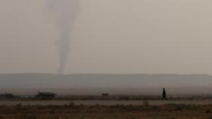 Khói lửa chiến sự bốc lên từ Deir al-Zor, Syria. (Ảnh chụp ngày 20/09/2017)
