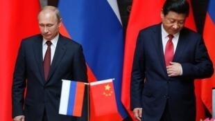 رؤسای جمهوری روسیه و چین، ولادیمیر پوتین و شین جینگ پینگ