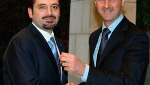 Le Premier ministre libanais Saad Hariri (g) accueilli par le président syrien Bachar el-Assad, le 19 décembre 2009, à Damas.