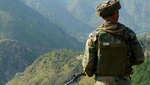 An Indian soldier on guard at Uri, near Line of Control between Indian and Pakistani-controlled Kashmir