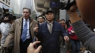 Hong Kong media tycoon Jimmy Lai (R), accompanied by his lawyer in Hong Kong January 21, 2015.
