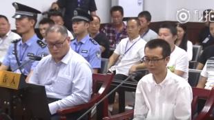 涉案人员李明哲和彭宇华在周一开庭时的资料图片