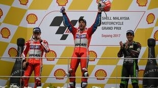 Andrea Dovizioso celebrates after winning the Malaysian MotoGP.