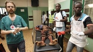 A man wounded at Bangui airport receives medical care