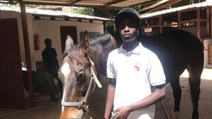 Alcaly Diouf with his horse Niagara at the stables in Senegal before compteing in the special Olympics 2019 in UAE