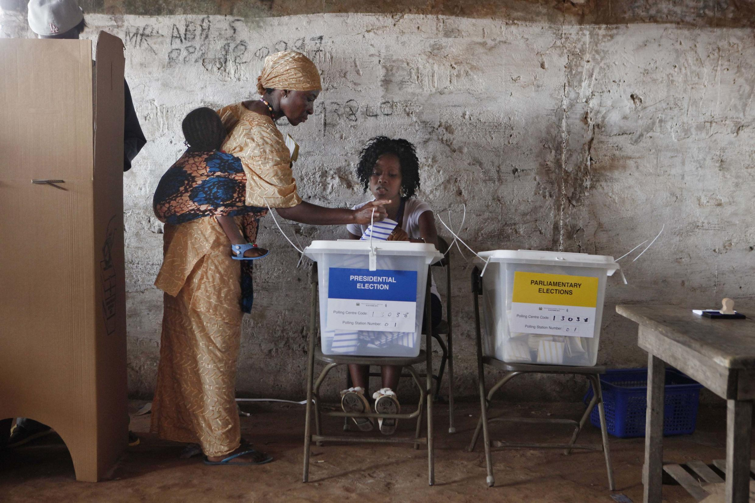 A Sierra Leonean casts her vote in the first round of elections, 2012