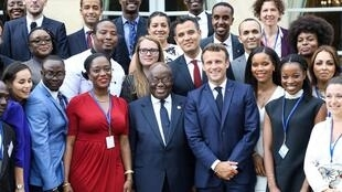 French President Emmanuel Macron and Ghanaian President Nana Akufo-Addo pose with members of the the African diaspora, in Paris, France July 11, 2019.