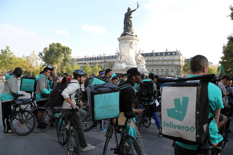Deliveroo riders protest Place de la République in Paris on 11 August, 2017.