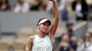 Veronika Kudermetova reached the second round of a Grand Slam event for the first time following her win over Caroline Wozniacki.