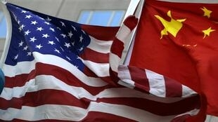 The national flags of the U.S. and China wave in front of a hotel in Beijing in this February 4, 2010 file photo.