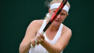 Britain's Francesca Jones plays a doubles match against Americans Amanda Anisimova and Alexandra Sanford during Wimbledon 2016