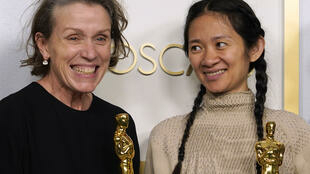 "Frances McDormand (L) won the Oscar for best actress in ""Nomadland"" -- her third acting win -- but also shared the film's award for best picture as one of its producers with director Chloe Zhao (R)"