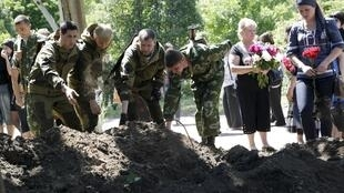 People attend a funeral of five fighters of the separatist self-proclaimed Donetsk People's Republic, Donetsk on 6 June, 2015
