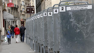 Panels await posters outside a polling station in France