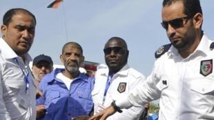 Abdallah al-Senoussi sous bonne escorte policière, le 19 septembre 2013 à Tripoli.